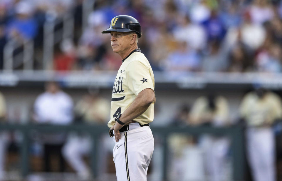 Vanderbilt head coach Tim Corbin watches from third base in the eighth inning during a baseball game against North Carolina State in the College World Series, Monday, June 21, 2021, at TD Ameritrade Park in Omaha, Neb. (AP Photo/Rebecca S. Gratz)