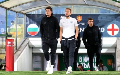 <span>Brave Sir Harrys: Maguire and Kane inspect the pitch in Sofia</span> <span>Credit: Catherine Ivill/Getty Images </span>