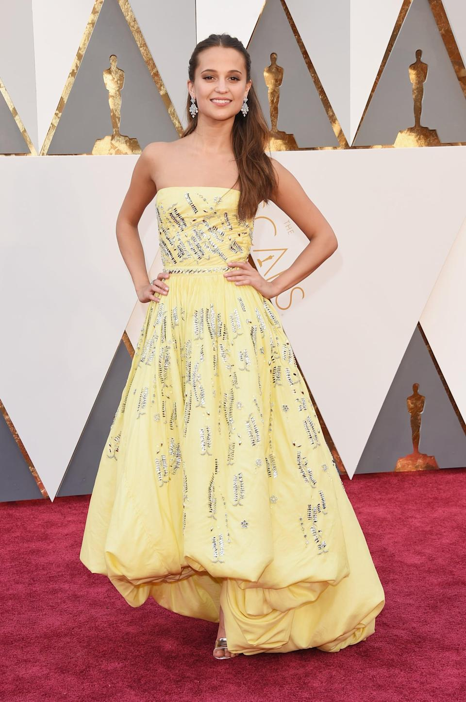 <p>Alicia Vikander wore a pastel yellow custom Louis Vuitton dress with sparkly details at the Oscars in 2016.</p>