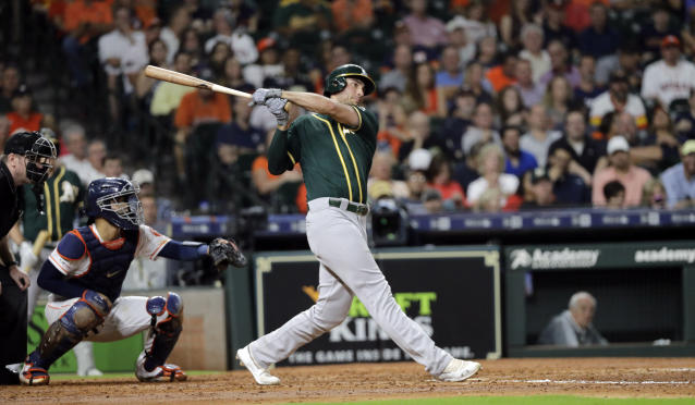 Oakland Athletics' Matt Olson, right, hits a two-run home run as Houston Astros catcher Robinson Chirinos reaches for the pitch during the third inning of a baseball game Tuesday, Sept. 10, 2019, in Houston. (AP Photo/David J. Phillip)