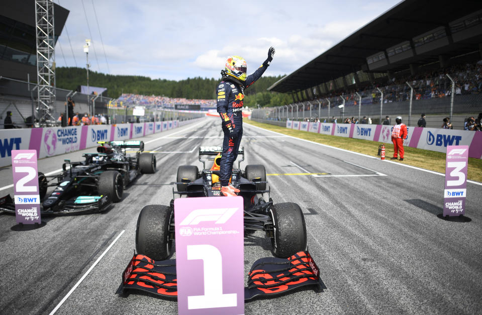 Red Bull driver Max Verstappen of the Netherlands jubilates on top of his car after winning the Austrian Formula One Grand Prix at the Red Bull Ring racetrack in Spielberg, Austria, Sunday, July 4, 2021. (Christian Bruna/Pool Photo via AP)