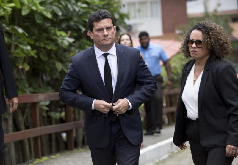 Judge Sergio Moro leaves a meeting with President-elect Jair Bolsonaro, outside Bolsonaro's home in Rio de Janeiro, Brazil, Thursday, Nov. 1, 2018. Bolsonaro has said he wants Moro to be justice minister or to fill the next vacancy on the Supreme Federal Tribunal, Brazil's top court. Moro told the AP in a statement earlier this week he was honored and considering the possibilities. (AP Photo/Silvia Izquierdo)
