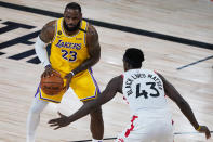 Toronto Raptors' Pascal Siakam (43) guards Los Angeles Lakers' LeBron James (23) during the first half of an NBA basketball game Saturday, Aug. 1, 2020, in Lake Buena Vista, Fla. (AP Photo/Ashley Landis, Pool)
