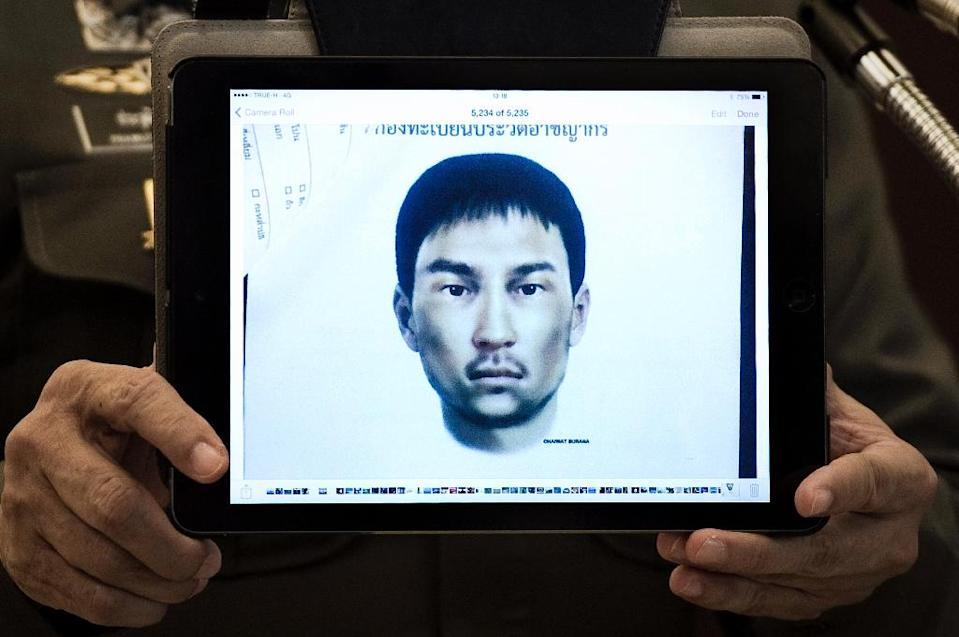 Thailand's national police spokesman Prawut Thavornsiri holds a tablet displaying a picture of an unnamed foreign man, wanted for questioning after bomb making materials were found in a Bangkok apartment he allegedly rented (AFP Photo/Nicolas Asfouri)