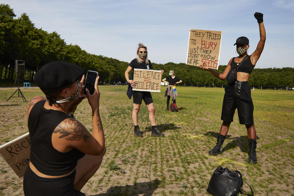 THE HAGUE, NETHERLANDS - JUNE 02: A protester holds a sign in protest as people gather on Malieveld in The Hague to attend a solidarity rally against racism in the aftermath of the killing of George Floyd by U.S. police officers on June 2, 2020 in The Hague, Netherlands. The rally is organized by KOZP (Kick Out Zwarte Piet), anti-racist activists against the Dutch Christmas tradition when people paint their face black and disguise in slave. (Photo by Pierre Crom/Getty Images)