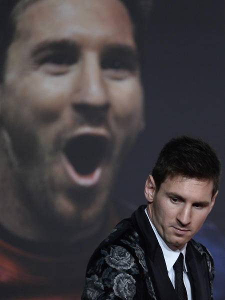 Barcelona's Lionel Messi from Argentina poses for the media after receiving his Golden Boot award for scoring the most goals in Europe's domestic leagues last season in Barcelona, Spain, Wednesday, Nov. 20, 2013. (AP Photo/Manu Fernandez)