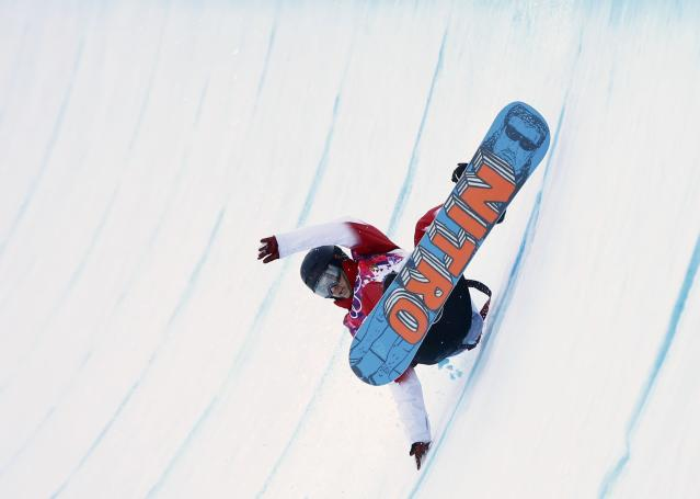 Canada's Brad Martin competes during the men's snowboard halfpipe qualification round at the 2014 Sochi Winter Olympic Games in Rosa Khutor February 11, 2014. REUTERS/Mike Blake (RUSSIA - Tags: SPORT OLYMPICS SPORT SNOWBOARDING)