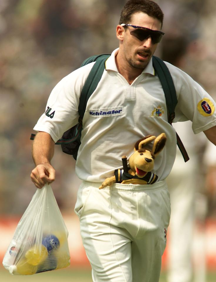14 Mar 2001:   Damien Fleming of Australia carries the drinks with the team mascot in his trousers, during day four of the 2nd Test between India and Australia played at Eden Gardens, Calcutta, India. X DIGITAL IMAGE  Mandatory Credit: Hamish Blair/ALLSPORT
