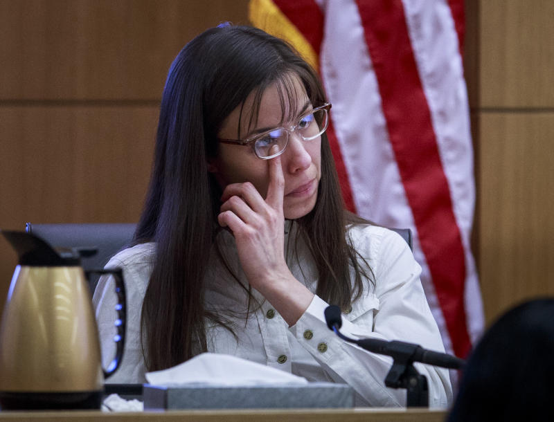 Defendant Jodi Arias talks about the text messages with Travis Alexander from March through May 2008, as she testifies in her murder trial st Judge Sherry Stephens' Superior Court , on Tuesday, Feb. 19, 2013.  Arias is charged in the 2008 stabbing and shooting death of her lover, Alexander.  She faces the death penalty if convicted of first-degree murder.  (AP Photo/The Arizona Republic, Charlie Leight, Pool)