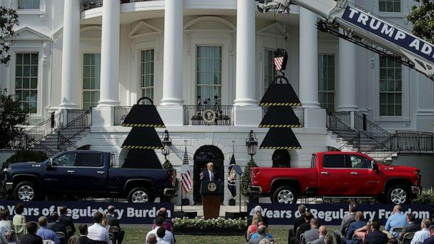 PHOTO: President Donald Trump is flanked by pickup trucks as he speaks about administration efforts to curb federal regulations during an event on the South Lawn of the White House in Washington, July 16, 2020. (Jonathan Ernst/Reuters)