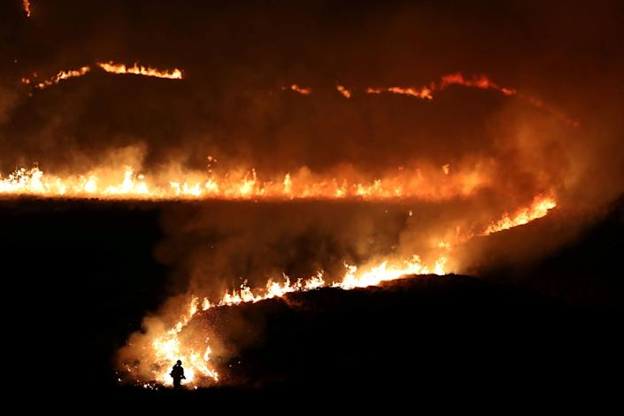 A fire is seen burning on Saddleworth Moor near the town of Diggle, Britain, February 27, 2019.