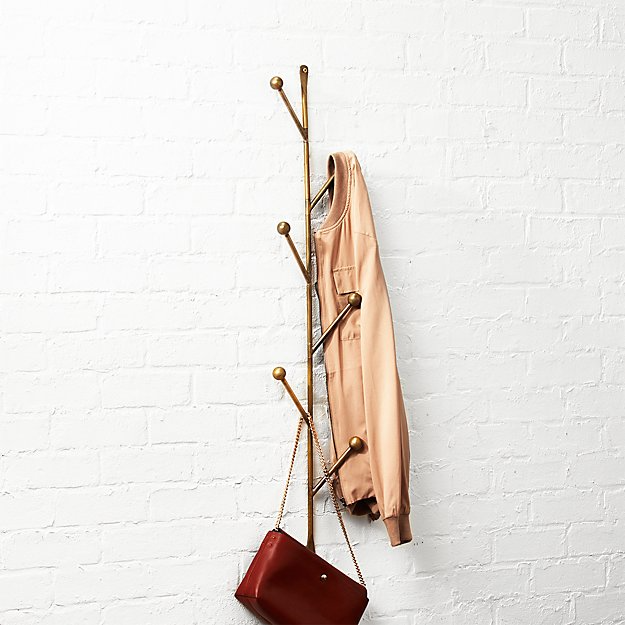 "<h3><a href=""https://www.cb2.com/barker-vertical-wall-mounted-coat-rack/s333594"" rel=""nofollow noopener"" target=""_blank"" data-ylk=""slk:CB2 Barker Vertical Wall Mounted Coat Rack"" class=""link rapid-noclick-resp"">CB2 Barker Vertical Wall Mounted Coat Rack</a></h3><br><strong>When your entryway is a cluttered heap of bags, coats, and hats: </strong>Get them off the ground and streamlined with this tree-style organizer that attaches easily to the wall.<br><br><strong>CB2</strong> Barker Vertical Wall Mounted Coat Rack, $, available at <a href=""https://go.skimresources.com/?id=30283X879131&url=https%3A%2F%2Fwww.cb2.com%2Fbarker-vertical-wall-mounted-coat-rack%2Fs333594"" rel=""nofollow noopener"" target=""_blank"" data-ylk=""slk:CB2"" class=""link rapid-noclick-resp"">CB2</a>"
