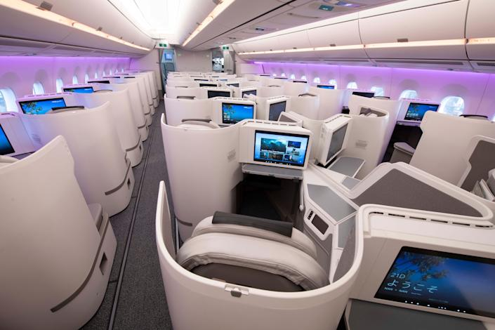Purple mood lighting aligns this first-class cabin on Fiji Airways.