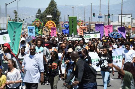 Protesters march from the intersection of Florence and Normandie Avenue, the flashpoint where the riots started 25 years ago, to a nearby park for a rally to remember and honor the victims of the 1992 Los Angeles riots in Los Angeles, California, U.S., April 29, 2017. REUTERS/Kevork Djansezian