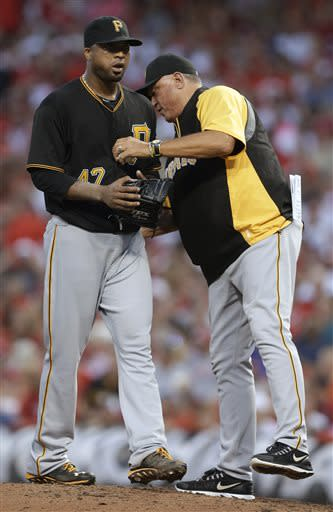 Pittsburgh Pirates manager Clint Hurdle takes starting pitcher Francisco Liriano out in the fifth inning of a baseball game against the Cincinnati Reds, Friday, July 19, 2013, in Cincinnati. Liriano was charged with five runs in four and one-third innings. (AP Photo/Al Behrman)