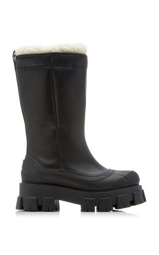 <p>These <span>Prada Lug Sole Shearling-Trimmed Leather Boots</span> ($1,350) have been on our mind for weeks now. They're cozy, cool, and classic; basically, they'd make for a great gift (hint, hint!)</p>