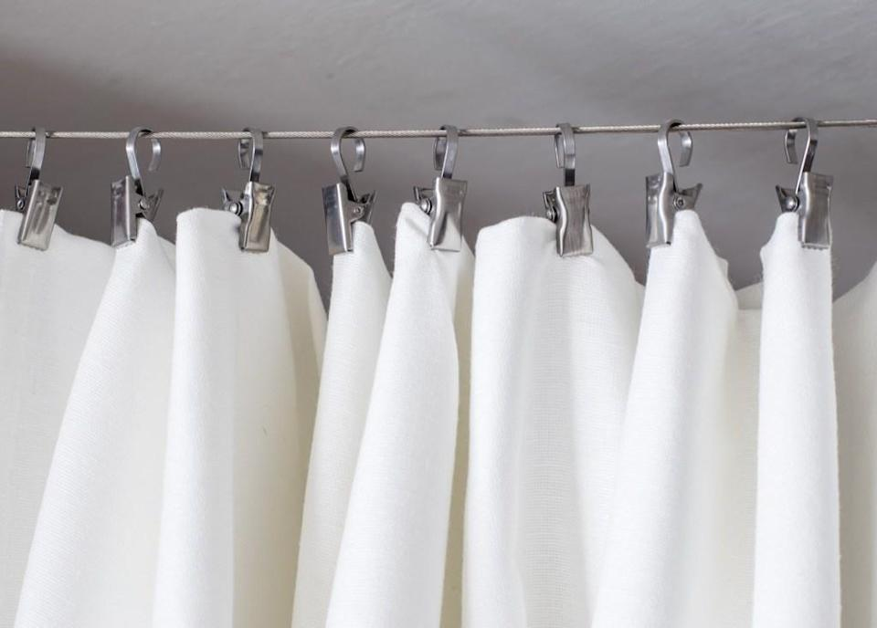 Instead of trying to remove the soap scum from your shower curtain while it's hanging, run it on a gentle wash cycle in your washing machine. To boost the soap scum-removal power, toss a little ammonia in there, and allow it to hang dry.