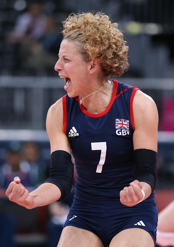 LONDON, ENGLAND - JULY 30:  Maria Bertelli of Great Britain celebrates winning a point in the Women's Volleyball Preliminary match between Great Britain and Algeria on Day 3 of the London 2012 Olympic Games at Earls Court on July 30, 2012 in London, England.  (Photo by Elsa/Getty Images)