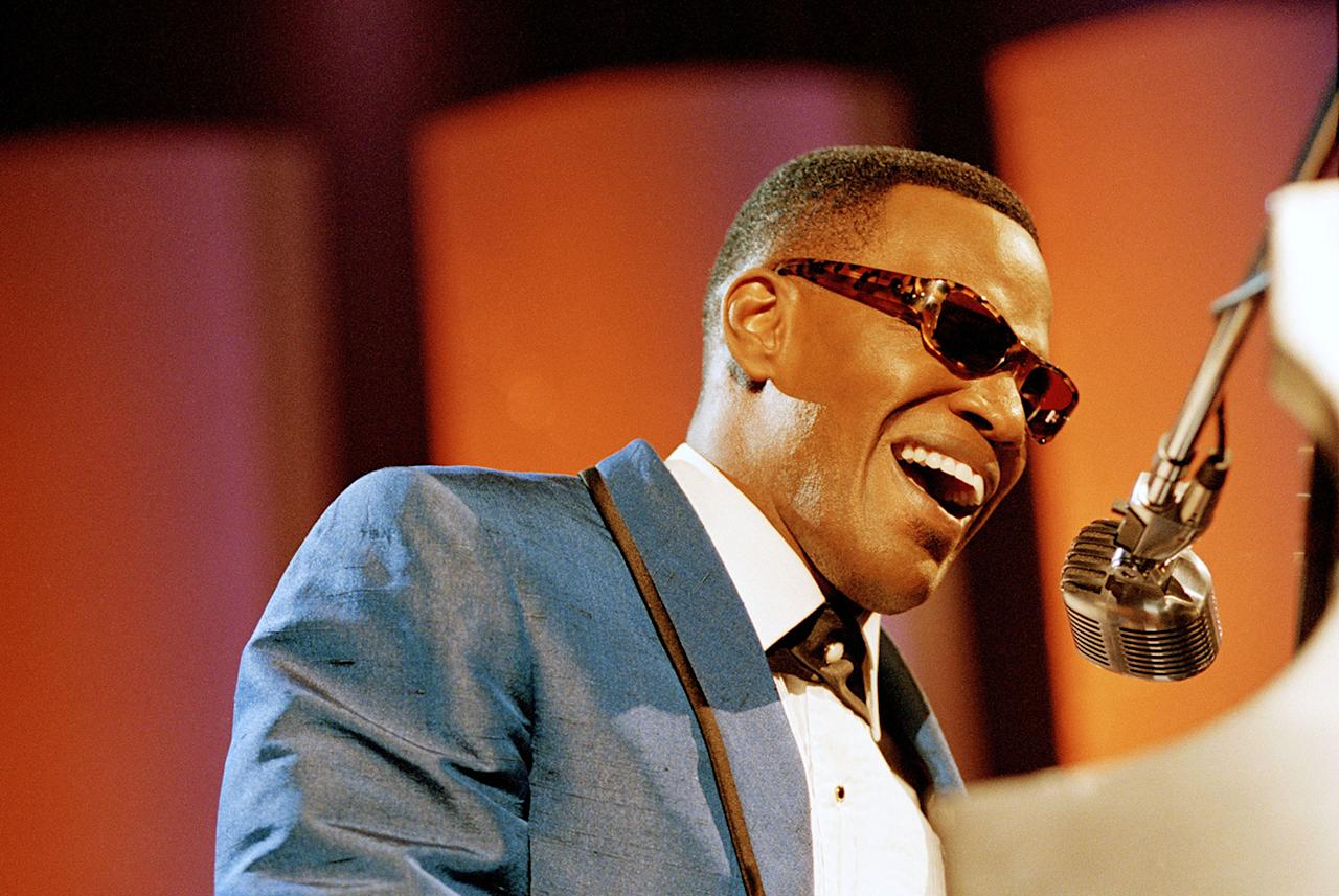 """Jamie Foxx, tickling the ivories. Actors sometimes get to meet the people they're portraying, but Ray Charles actually ran Foxx through a musical test for the biopic """"Ray"""" (2004). """"He said, 'If you can play the blues, Jamie, you can do anything,'"""" Foxx recounted to the BBC. Charles played notes and Foxx — who attended college on a piano scholarship — would keep up, until a Thelonious Monk riff had Foxx sweating on the ivories for 15 minutes. """"He goes, 'The notes are right there under your fingers, Jamie. You just have to take the time out to find them, young man.'"""" Once Foxx nailed the chord, Charles granted his blessing. Foxx matched Al Pacino in Oscar history as the only male actor to win two acting Oscar nominations in one year (the second was for """"Collateral Damage"""")."""