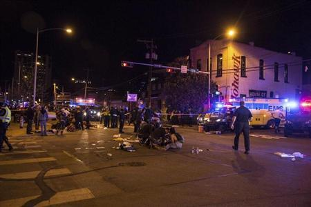 Patients who were struck by a vehicle on Red River Street during the SXSW festival is assisted in downtown Austin