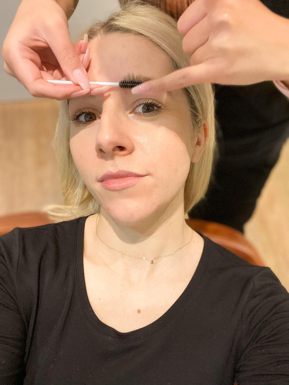 <p>The first step of the brow lamination process is to fix the hairs in place using brow lamination glue. It feels like a thick adhesive and is literally sticking your brow hairs into your chosen shape and style - mine were stuck pointing straight upward.</p>