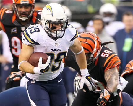 Jan 5, 2014; Cincinnati, OH, USA; San Diego Chargers running back Danny Woodhead (39) runs the ball during the third quarter against the Cincinnati Bengals during the AFC wild card playoff football game at Paul Brown Stadium. Mandatory Credit: Pat Lovell-USA TODAY Sports