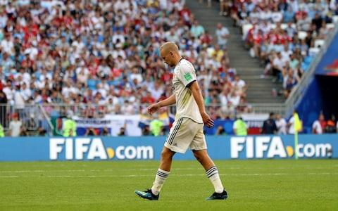 Igor Smolnikov of Russia walks off dejected after being sent off during the 2018 FIFA World Cup Russia group A match between Uruguay and Russia at Samara Arena on June 25, 2018 in Samara, Russia - Credit: Getty Images