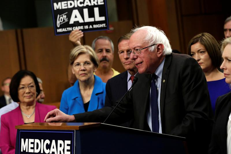 """Sen. Bernie Sanders (I-Vt.) unveils the """"Medicare for All Act of 2017"""" alongside colleagues and activists on Sep. 13, 2017. (Yuri Gripas / Reuters)"""