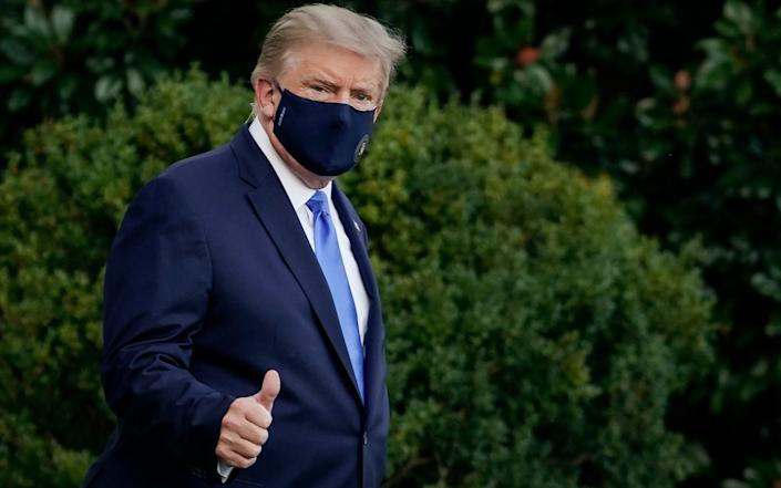Mr Trump leaving the White House to travel to hospital - Drew Angerer/Getty Images North America
