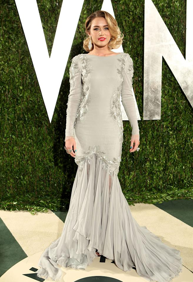 "Also photographed entering the Vanity Fair fete was former Disney darling, Miley Cyrus, who channeled Old Hollywood in a glamorous Roberto Cavalli gown, chandelier earrings, ruby-red lips, and a classic coif.<br><br><a target=""_blank"" href=""http://bit.ly/lifeontheMlist"">Follow Matt Whitfield on Twitter!</a>"