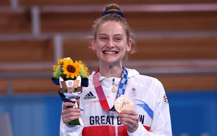 Bryony Page poses with her medal - REUTERS