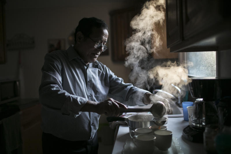 Dhan Tumbapoo, Amber Subba's father, makes tea at home. He lives with his wife, son, his son's wife and their two children.