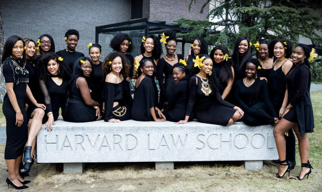 "Harvard Law School women posing with yellow flowers in their hair that represent ""friendship, filial love, warmth, compassion, and gentleness,"" as explained by Jazzmin Carr. (Photo: Will Sterling)"