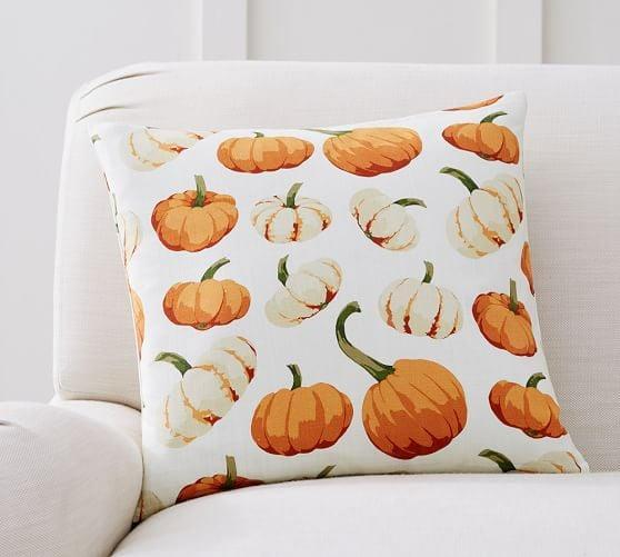 <p>Add a little spice to your sofa with this <span>Scattered Pumpkin Pillow Cover</span> ($11, originally $30).</p>