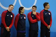 <p>Gold medalists Ryan Murphy, Cody Miller, Michael Phelps and Nathan Adrian of the United States pose on the podium during the medal ceremony for the Men's 4 x 100m Medley Relay Final on Day 8 of the Rio 2016 Olympic Games at the Olympic Aquatics Stadium on August 13, 2016 in Rio de Janeiro, Brazil. (Photo by Al Bello/Getty Images) </p>