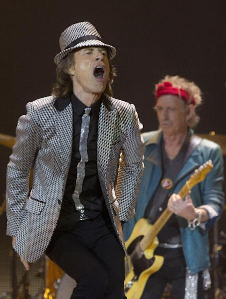 Mick Jagger, left and Keith Richards, of The Rolling Stones perform at the O2 arena in east London, Sunday, Nov. 25, 2012. The band are playing five gigs to celebrate their 50th anniversary, including two shows at London's O2 and three more in New York. (Photo by Joel Ryan/Invision/AP)