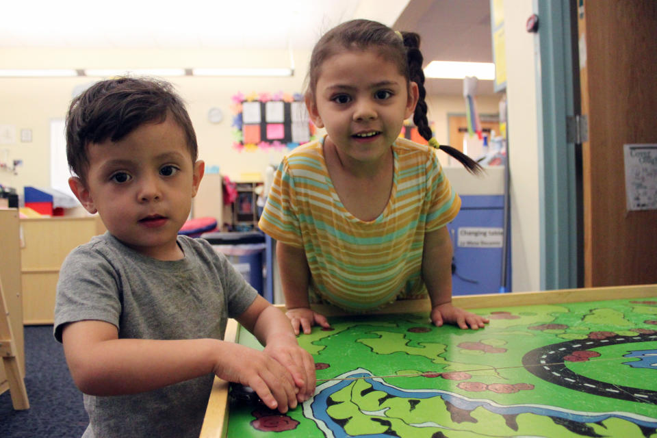 Students Arelyanna, 3, and Javier, 2, play with their toy cars to wrap up the day at Cuidando Los Ninos in Albuquerque, N.M. The charity provides housing, child care and financial counseling for mothers, all of whom will benefit from expanded Child Tax Credit payments that will start flowing in July to roughly 39 million households. (AP Photo/Susan Montoya Bryan)