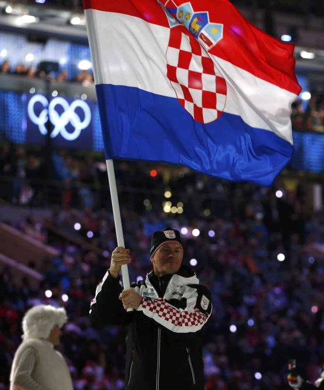 Croatia's flag-bearer Ivica Kostelic leads his country's contingent as they march in during the opening ceremony of the 2014 Sochi Winter Olympics, February 7, 2014. REUTERS/Jim Young (RUSSIA - Tags: OLYMPICS SPORT)