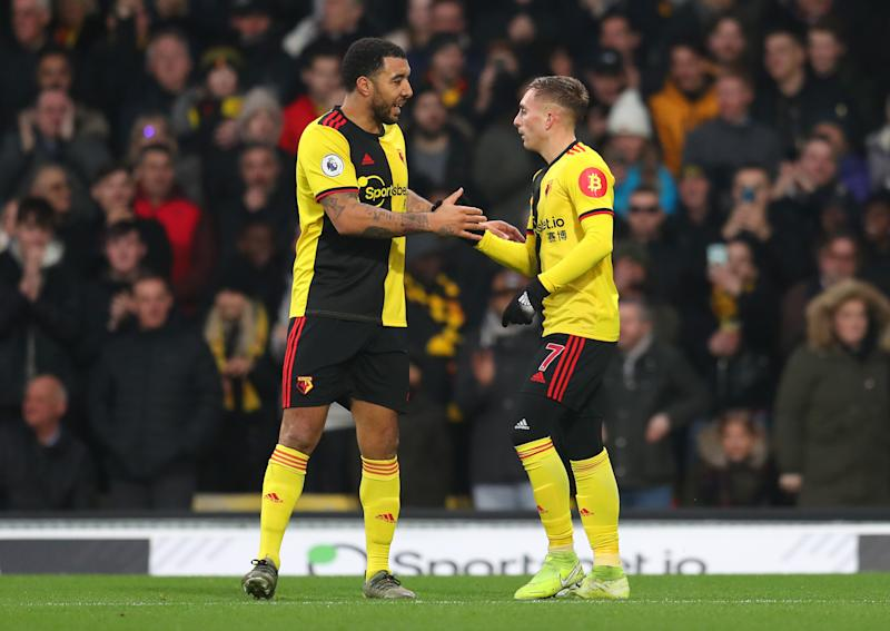 WATFORD, ENGLAND - JANUARY 01: Gerard Deulofeu of Watford celebrates after scoring his sides first goal with teammate Troy Deeney of Watford during the Premier League match between Watford FC and Wolverhampton Wanderers at Vicarage Road on January 01, 2020 in Watford, United Kingdom. (Photo by Catherine Ivill/Getty Images)
