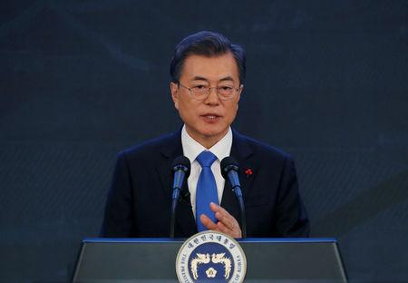 South Korean President Moon Jae-in delivers a speech during his New Year news conference at the Presidential Blue House in Seoul