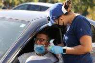 Alex Vazquez, 42, is given a PCR coronavirus test, as the global outbreak of the coronavirus disease (COVID-19) continues, in Malibu