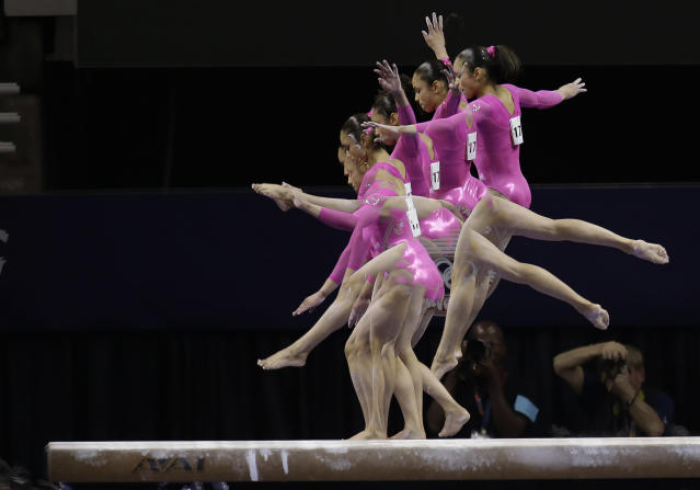 In this multiple exposure frame taken at one-fifth of a second intervals, Sabrina Vega performs on the balance beam during the preliminary round of the women's Olympic gymnastics trials, Friday, June 29, 2012, in San Jose, Calif. (AP Photo/Julie Jacobson)