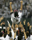 Japan's Chiba Lotte Marines' manager Bobby Valentine (top) of the U.S. is tossed into the air by his teammates after winning the final of the baseball Asia Series 2005 at Tokyo Dome in Tokyo, November 13, 2005. Marines beat Lions 5-3. REUTERS/Toru Hanai