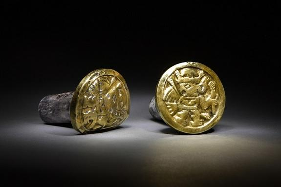 Images of winged beings adorn a pair of gold-and-silver ear ornaments a high-ranking Wari woman wore to her grave. Archaeologists found the remains of 63 individuals, including three Wari queens, in the imperial tomb at El Castillo de Huarmey.