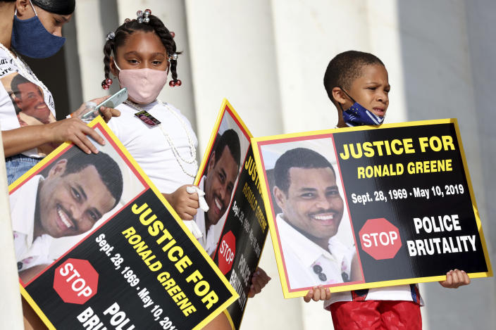 """FILE - In this Aug. 28, 2020 file photo, family members of Ronald Greene listen to speakers as demonstrators gather for the March on Washington, in Washington, on the 57th anniversary of the Rev. Martin Luther King Jr.'s """"I Have A Dream"""" speech. Officials told The Associated Press, federal authorities are investigating the death of Greene during what Louisiana State Police described as a struggle to take him into custody following a rural police chase last year. The death of the 49-year-old remains shrouded in secrecy because State Police have declined to release body-camera footage related to the May 2019 chase north of Monroe, La. (Michael M. Santiago/Pool via AP)"""