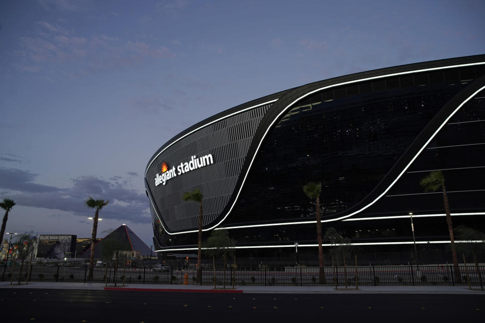 """FILE - In this July 22, 2020, file photo, lights adorn Allegiant Stadium, new home of the Las Vegas Raiders football team, as it nears completion in Las Vegas. Officials in Nevada have declared """"substantial completion"""" after nearly 1,000 days of construction of the $2 billion Allegiant Stadium in Las Vegas designed to be the home of the NFL's relocated Raiders. (AP Photo/John Locher, File)"""