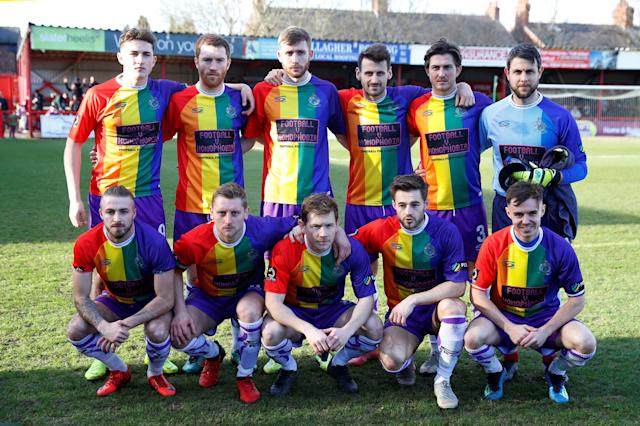 Members of Altrincham Football Club pose for a picture in their pro-LGBT kits before kickoff against Bradford AFC on Saturday. (Reuters)