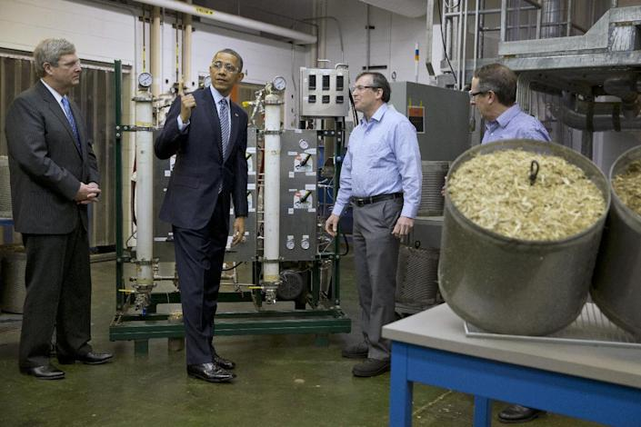 President Barack Obama, accompanied by Agriculture Secretary Tom Vilsack, left, tours the biomass conversion process area at Michigan Biotechnology Institute in Lansing, Mich., Friday, Feb. 7, 2014. In Michigan Obama is expected to speak about the farm bill. (AP Photo/Jacquelyn Martin)