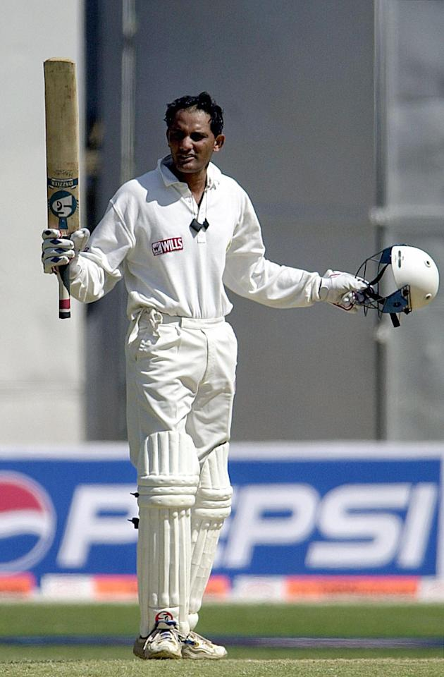 (FILES) In this picture taken on March 6, 2000, Indian cricketer Mohammad Azharuddin salutes the crowd after completing a century  on the final day of the second cricket Test match between South Africa and India in Bangalore.   Former India cricket captain Mohammad Azharuddin, who was forced to quit the game after being embroiled in a match-fixing scandal, is set to join politics. Azharuddin, 46, will be admitted to the ruling Congress party ahead of the upcoming parliamentary elections, party spokesman Veerappa Moily told Indian media on February 19, 2009.   AFP PHOTO/JOHN MACDOUGALL/FILES (Photo credit should read JOHN MACDOUGALL/AFP/Getty Images)