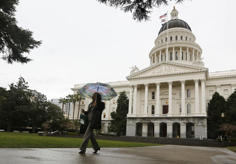 After a 52 day dry spell, umbrella were finally in need as the first storm of the new year moved into in Sacramento, Calif., Wednesday, Jan. 29, 2014. Storms are expected to move through Northern California bringing to the valley and snow to the mountains to help relieve the parched landscape. (AP Photo/Rich Pedroncelli)